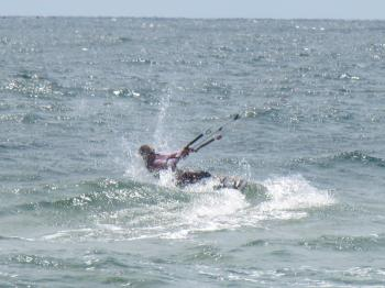 A kitesurfer at sea