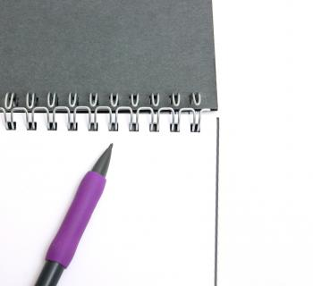 A pad of paper and a pencil isolated