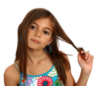 A pretty young girl pulling on her hair