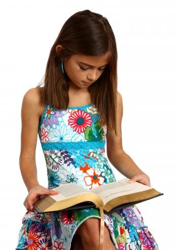 A pretty young girl reading a book