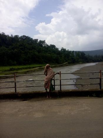 A rural indian women on small bridge