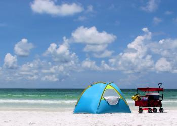A tent and buggy on a beach
