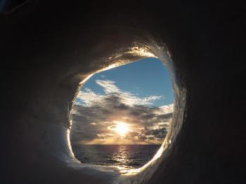 A view to the Sun through ship board