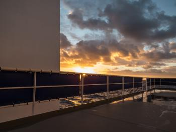 A view to the sunset from ship's deck