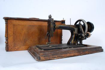 A vintage sewing machine from the 19th century