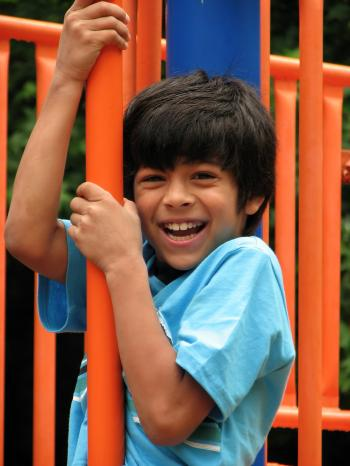 A young boy playing on a playground