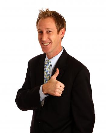 A young businessman giving a thumbs up