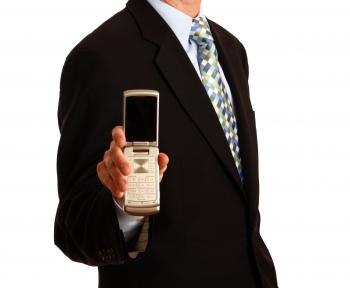 A young businessman holding a cell phone