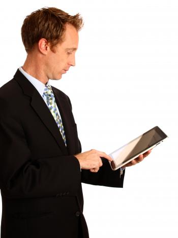 A young businessman holding a tablet com