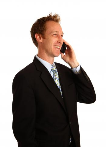 A young businessman talking on a cell ph