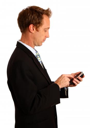 A young businessman using a smart phone