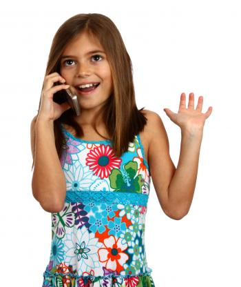 A young girl talking on a cell phone