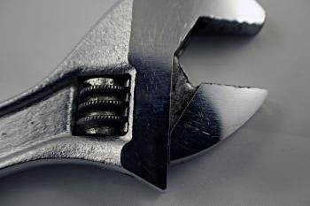 Adjustable steel wrench closeup