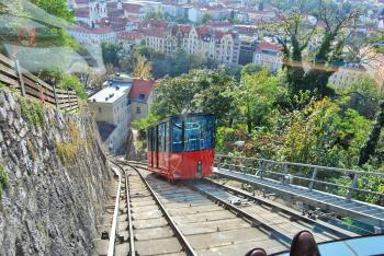Aerial Photography of Red and Black Train With Village View