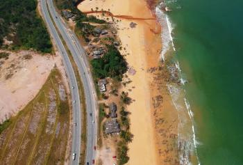 Aerial View of Road Beside the Seashore