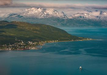 Aerial View Photography of Snow Covered Mountain Beside Ocean