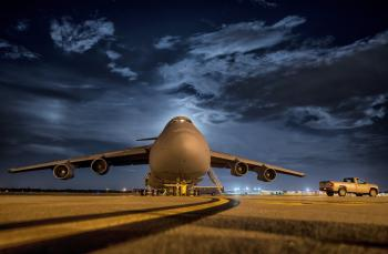 Airplane in Front and Night Sky