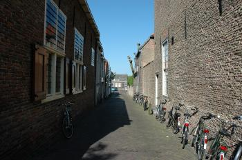 Alley with parked bicycles
