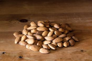 Almonds nuts on rustic wood