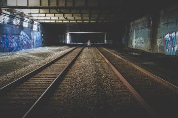 Alone in Train Tunnel