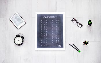 Alphabet Chalkboard at the Center of Assorted Items