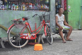 And Old Man with Old Red Bike