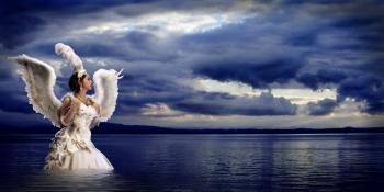 Angel by the beach