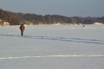 Angler on the frozen lake