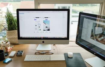 Apple Imac on Brown Wooden Desk