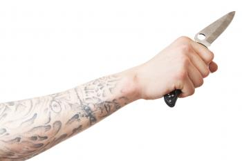 Arm with knife