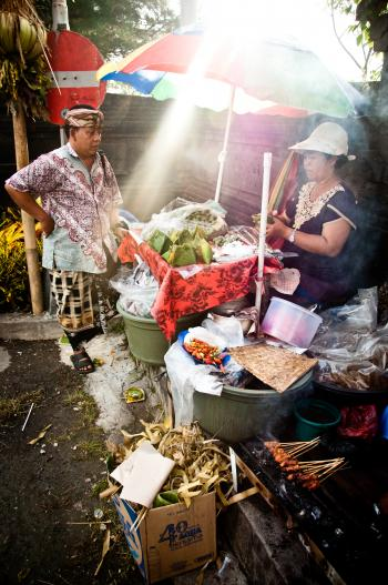 Asian woman selling food on the street