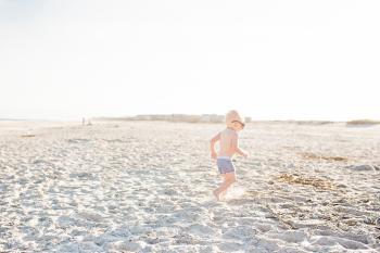 Baby Boy on Beach Wearing Sunglasses