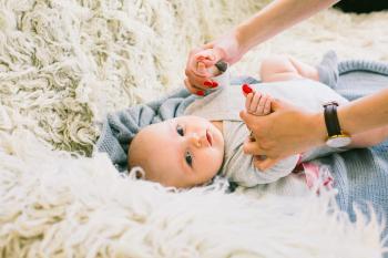 Baby in Gray Long-sleeved Onesie Lying on Beige Fur Textile