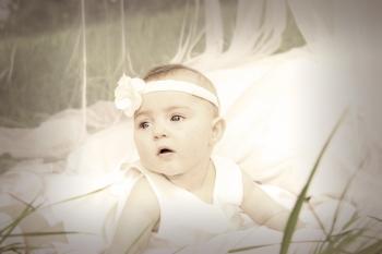 Baby in White Tank Dress and Headband