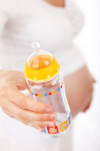 Baby's Feeding Bottle on Hand