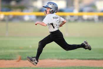 Baseball Player in Gray and Black Uniform Running