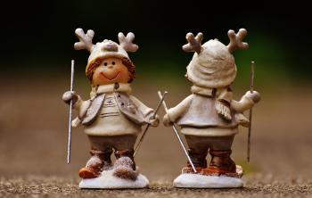 Beige and Brown Boy Skiing Figurine