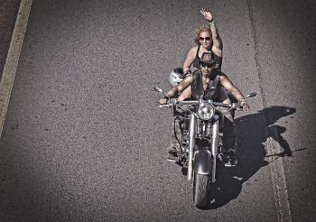 Biker waving on a chopper bike