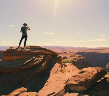 Birds Eye-view of a Man Standing on Grand Canyon