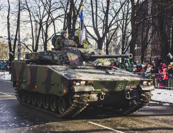 Black and Green Camouflage Military Tank Parade