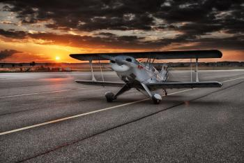 Black and White Aviation Plane Arriving during Sunset