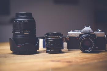 Black and White Dslr Camera Lens Beside Black Lens