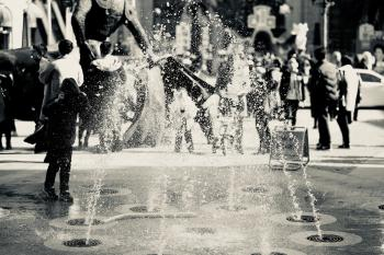 Black and White Photo of Fountain and People