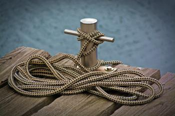 Black and White Rope Tied on Stainless Steel Tube