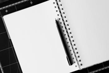 Black Ball-point Pen on White Notebook