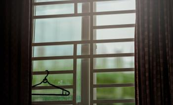 Black Clothes Hanger Hanged on Window
