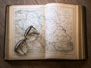 Black Framed Eyeglasses Map in Book