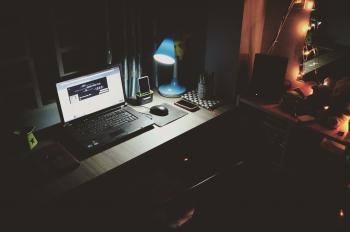 Black Laptop Beside Black Computer Mouse Inside Room