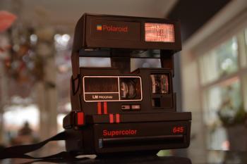 Black Polaroid Supercolor Camera on Black Table