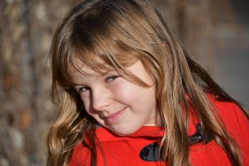 Blonde Girl Wearing Red Toggle Jacke